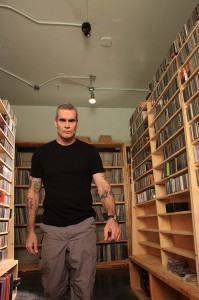 Henry Rollins in his library - photo by Maura Lanahan.