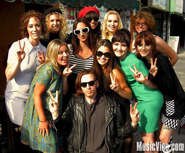 Music Vice editor Brian Banks surrounded by mod girls in a Bedouin Soundclash video shoot