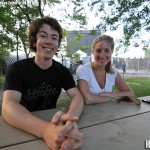 Ra Ra Riot's Milo Bonacci and Rebecca Zeller at a picnic table behind the scenes at Osheaga 2010, Montreal - photo by Brian Banks, Music Vice