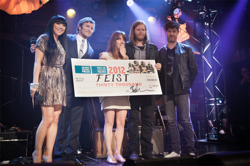 Feist receives the 2012 Polaris Prize winners cheque - photo credit Dustin Rabin