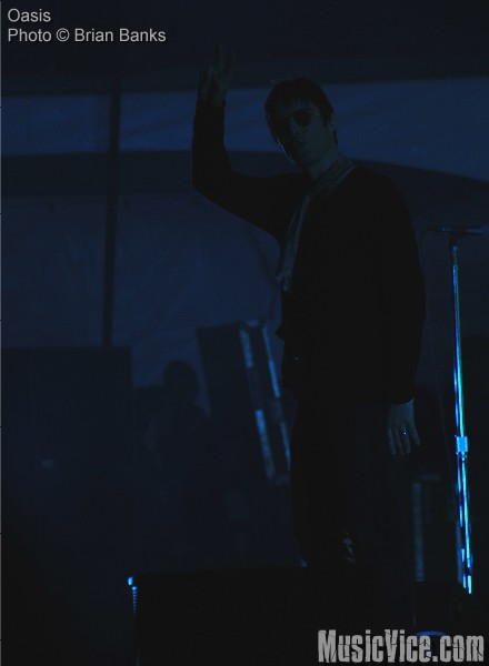 Liam Gallagher of Oasis throws the peace sign near the end of their concert, Virgin Festival Toronto 2008